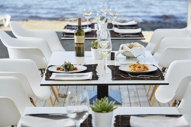 Dinning by the sea at Capo Di Corfu.
